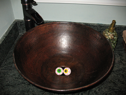 Soap eyeballs in the bottom of a sink.